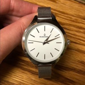 Silver wrist watch, one size fits most.